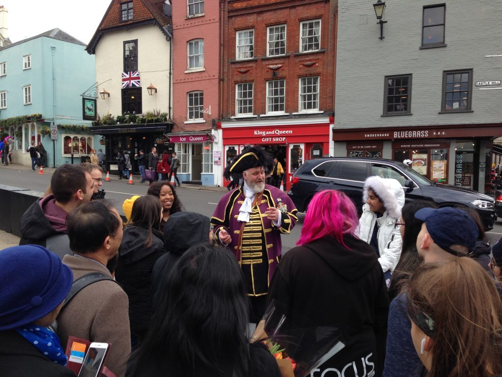 town crier with visitors